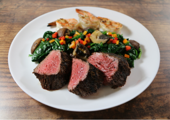 Surf and Turf over Garlicky Spinach and Mushrooms